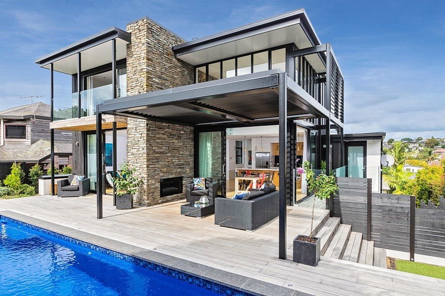 Stylish Contemporary Home with Living Spaces Separated by a Schist Stone Wall