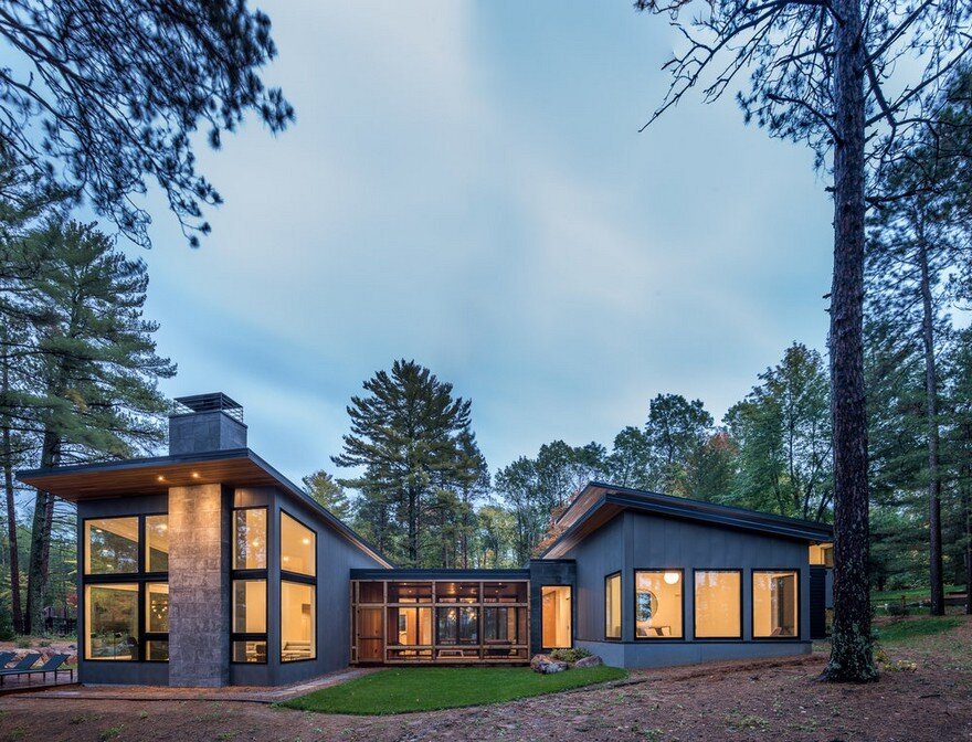 Northern Lake Home Blends into the Forested Landscape 1