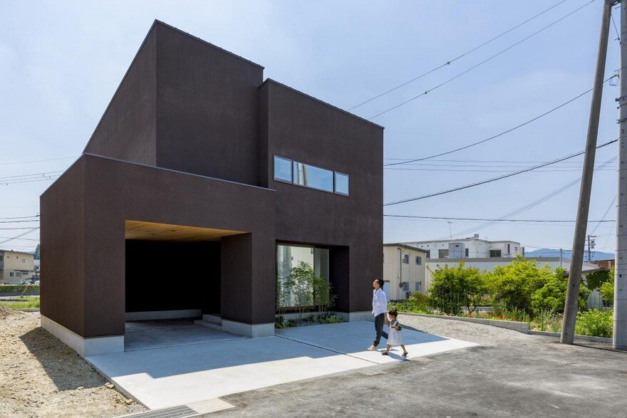 Box shaped japanese home with warm minimalist interior design