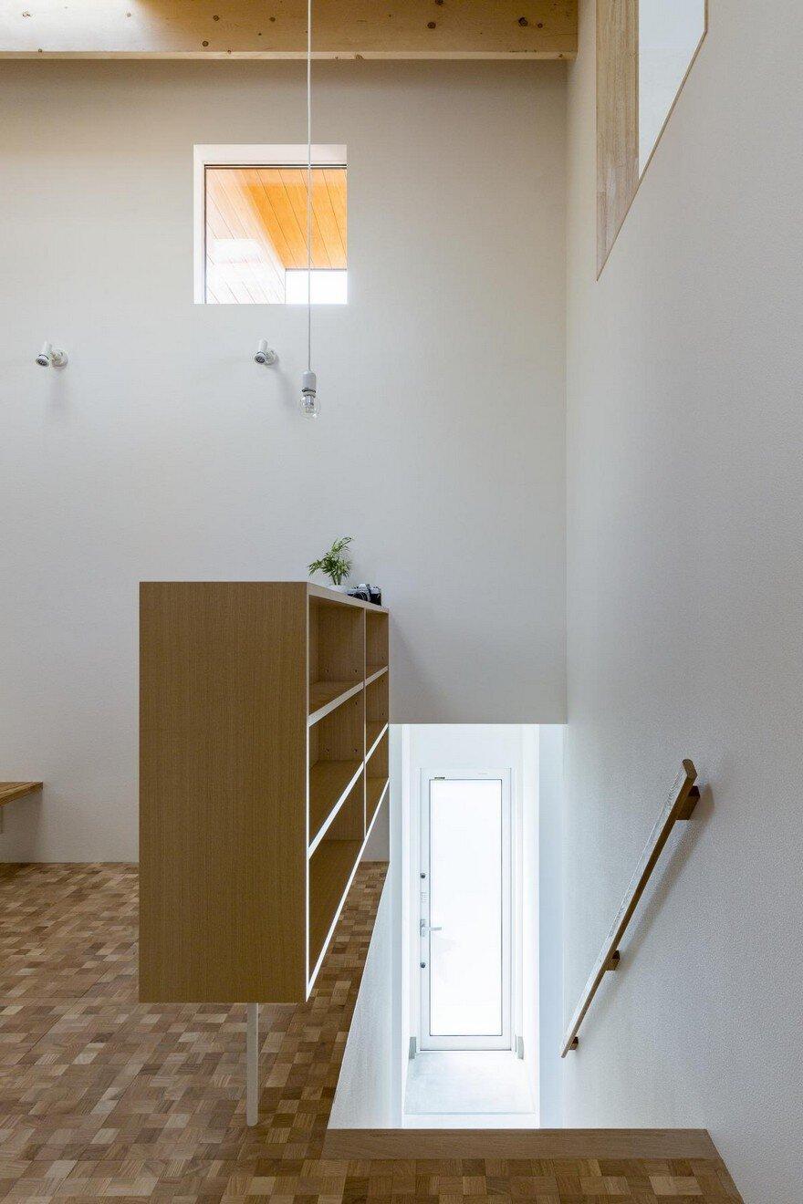 BoxShaped Japanese Home with Warm Minimalist Interior Design