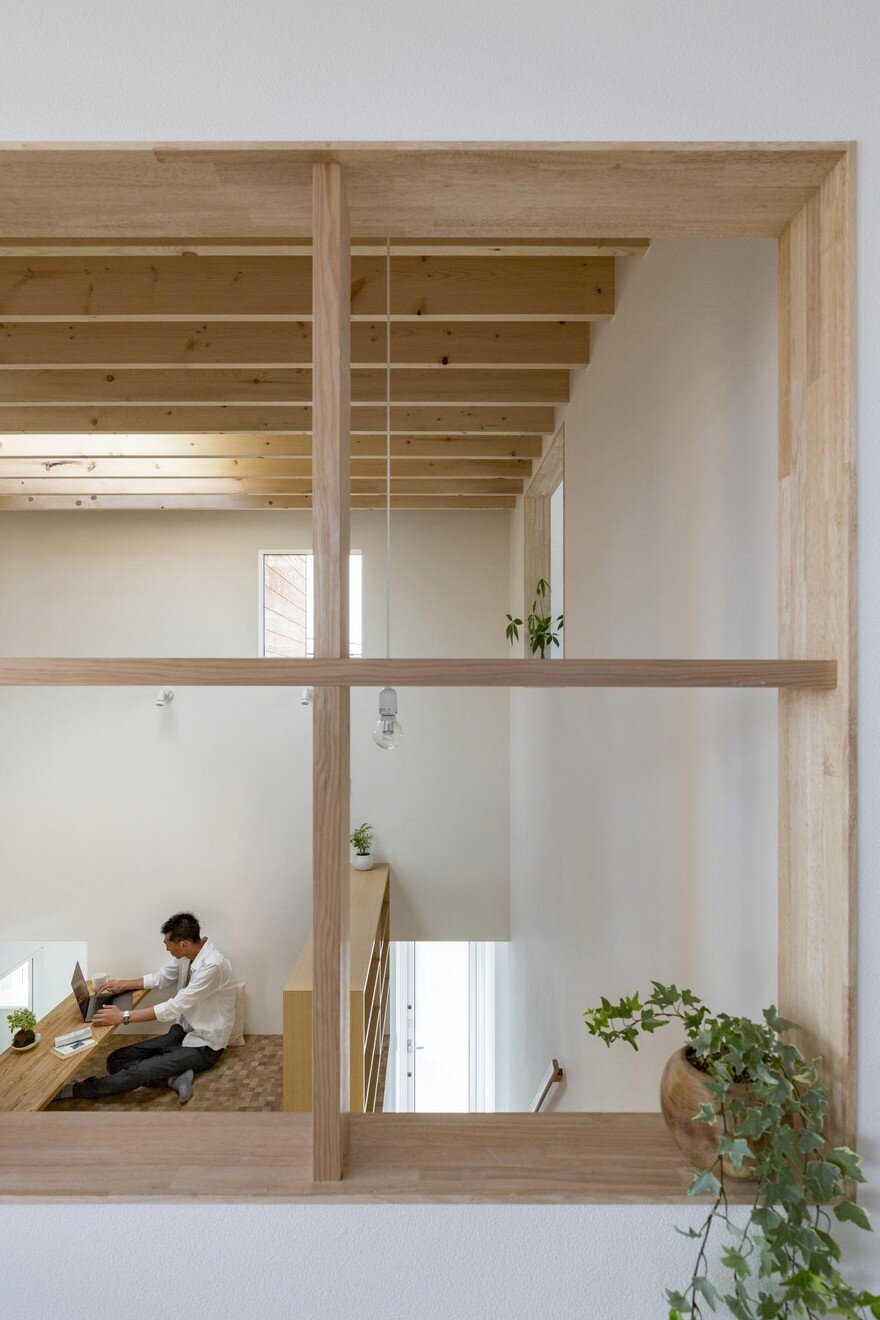 Box-Shaped Japanese Home with Warm Minimalist Interior Design 13