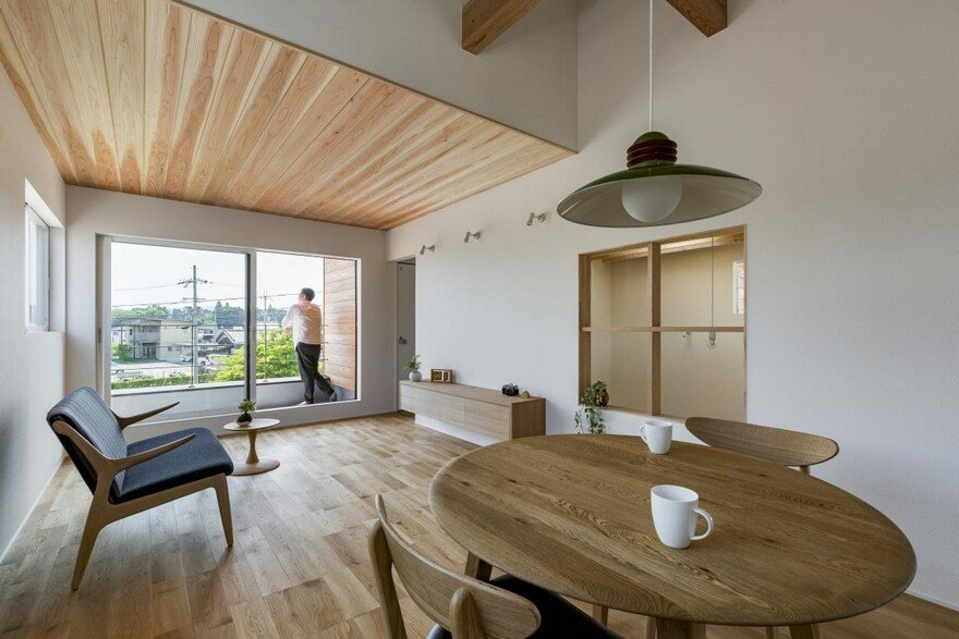 Box-Shaped Japanese Home with Warm Minimalist Interior Design