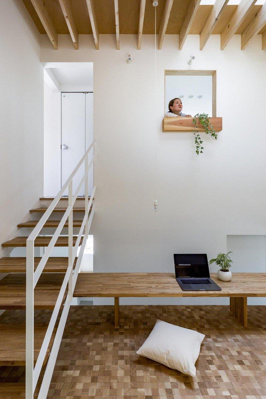 Box-Shaped Japanese Home with Warm Minimalist Interior Design