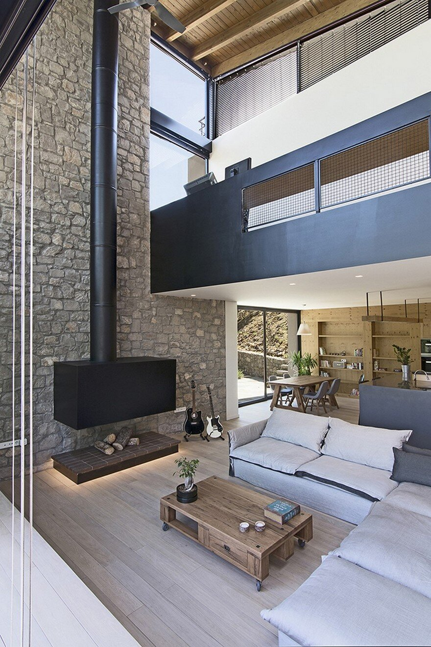 Custom Family Home In Athens That Blends With Its Natural
