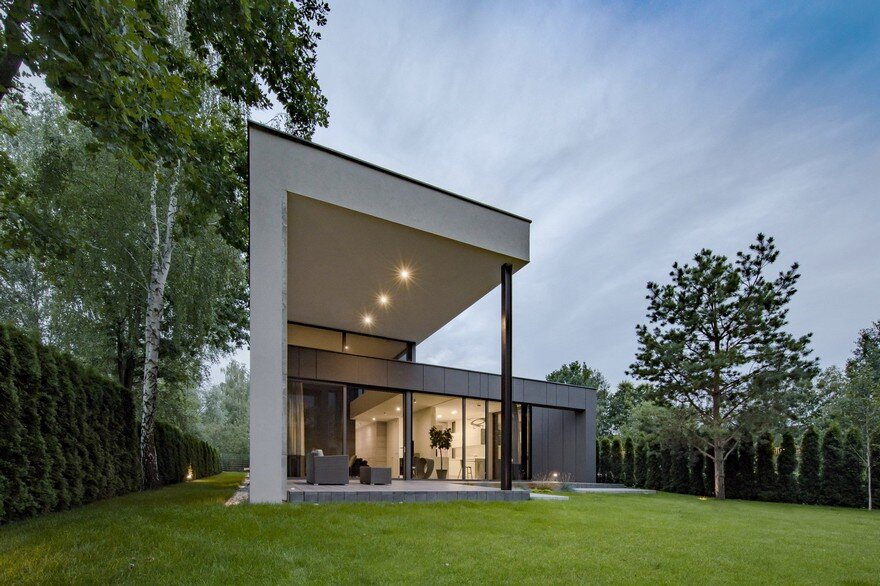 L Shaped Family Home Exhibiting A Distinctive Roof And Custom Interior 1