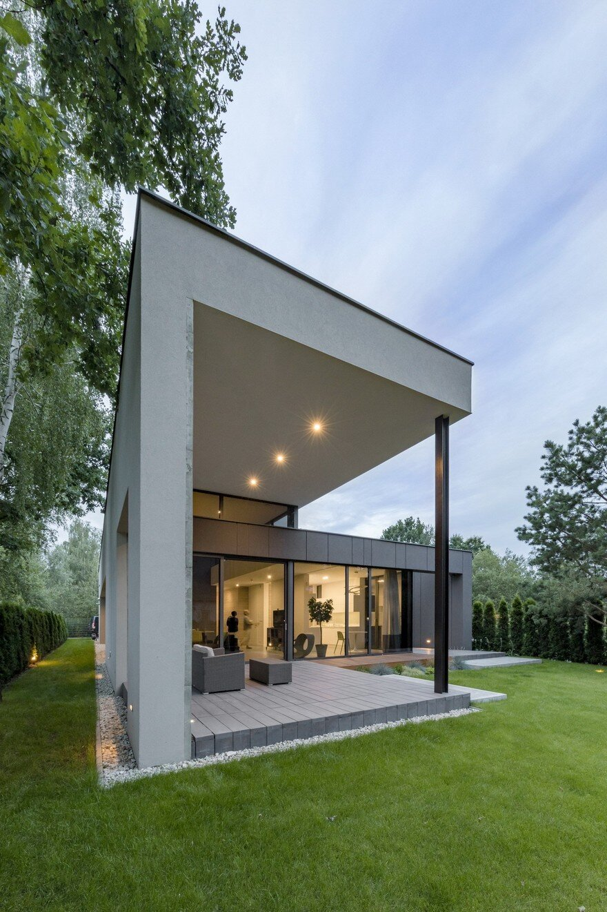L Shaped Family Home Exhibiting A Distinctive Roof And