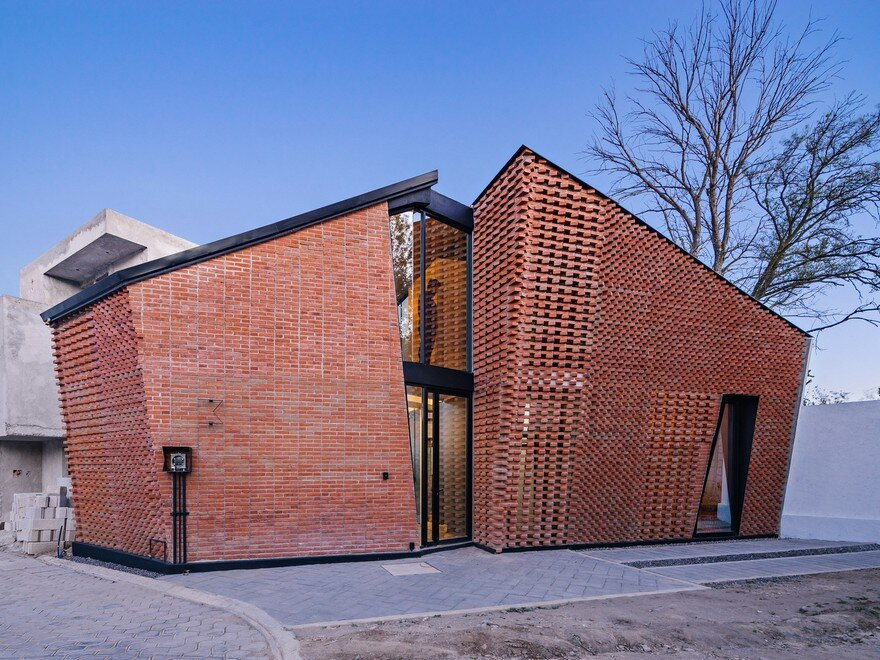 Red Brick House In Mexico With Bricks Arranged In An
