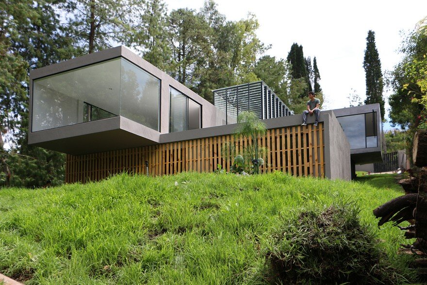 Contemporary Concrete House Suspended Like a Cloud Over Landscape
