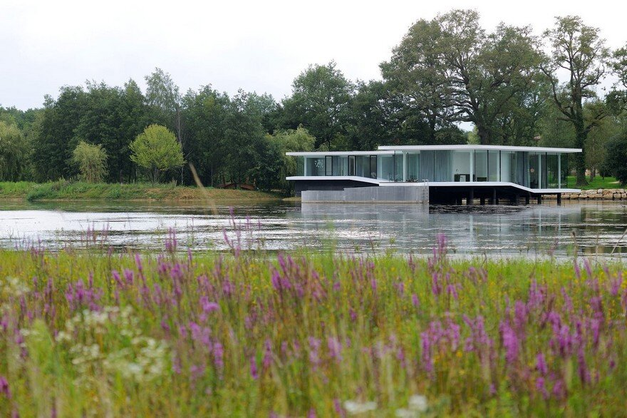 Concrete and Glass Residence Built on the Surface of a Lake: White Snake House