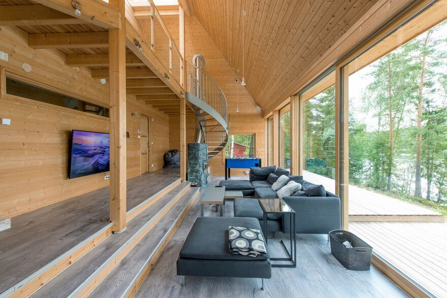 A Finnish Retreat Features a Pyramidal Roof and a Glass Wall Facade 5