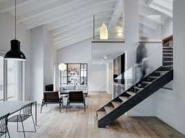 Stefano Viganò Designed a Double-Height Loft with an Industrial Personality