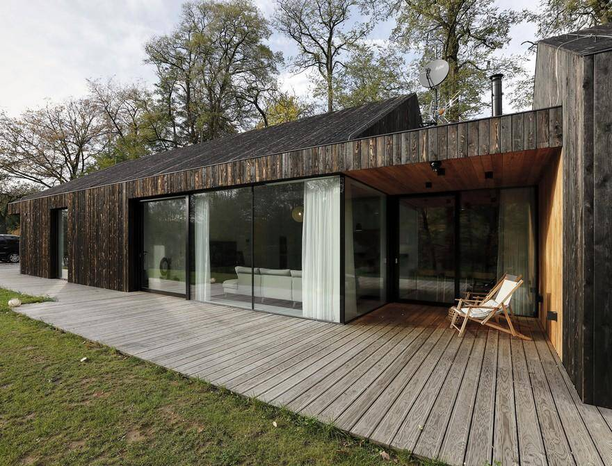 One-Story Family House Covered with Charred Larch Planks 1