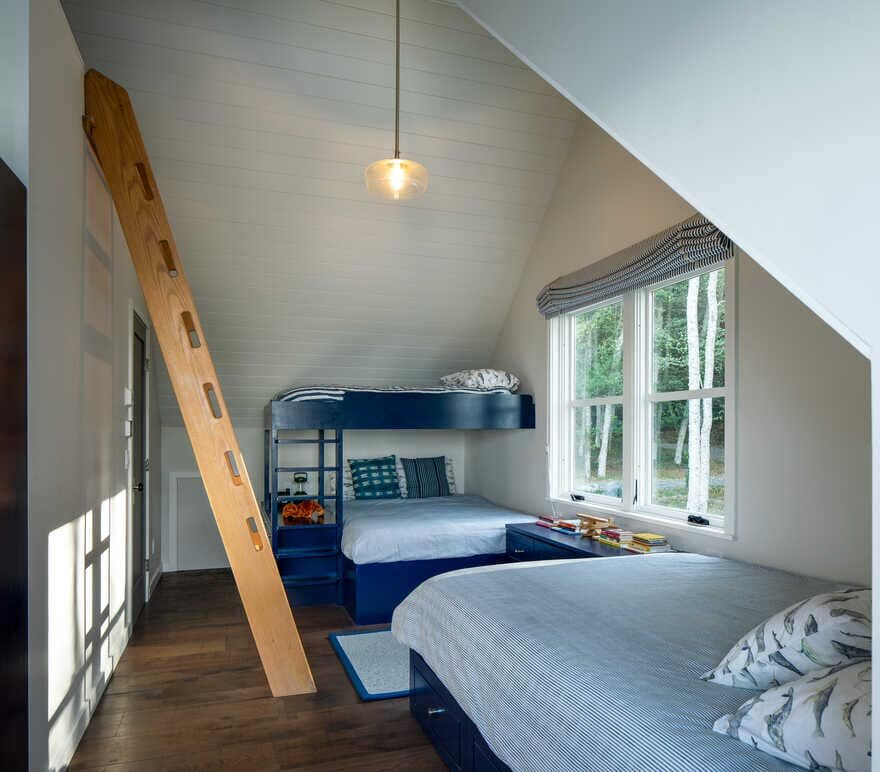 bedroom, a Renovated Waterfront Retreat by Heliotrope Architects