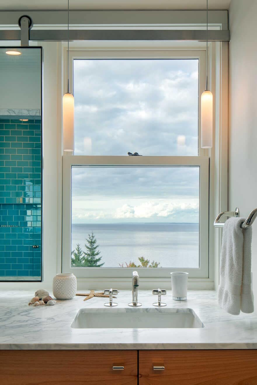 bathroom, a Renovated Waterfront Retreat by Heliotrope Architects