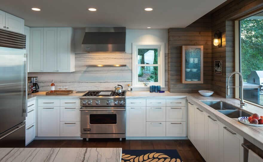 kitchen, a Renovated Waterfront Retreat by Heliotrope Architects