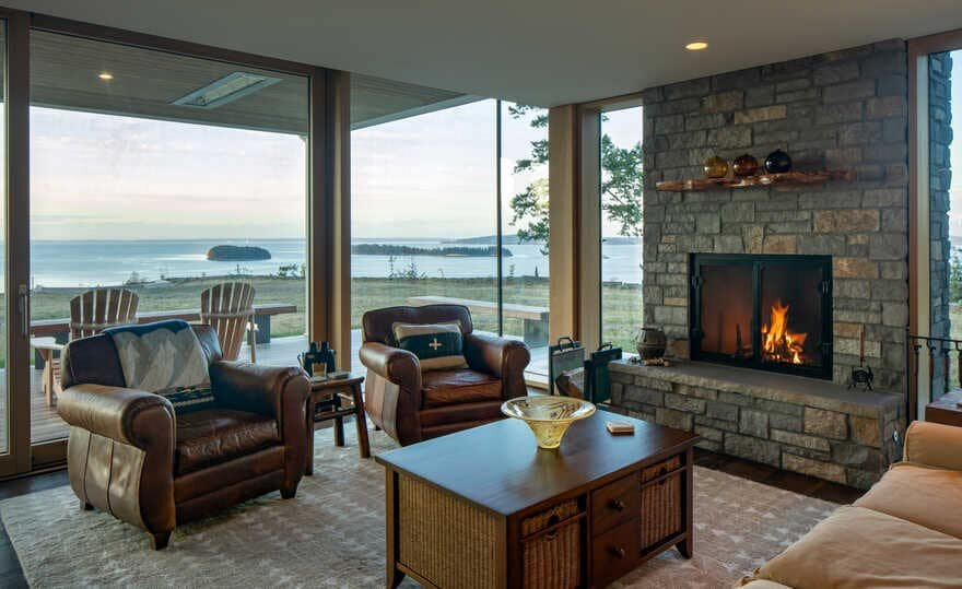 living room, a Renovated Waterfront Retreat by Heliotrope Architects