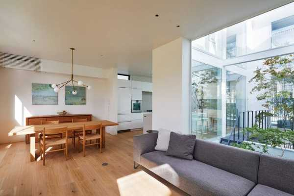 House Connected by Courtyard by Naf Architect & Design