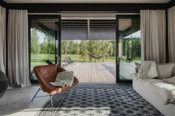 Sleek Pavilion-style Weekend House in Rural Latvia